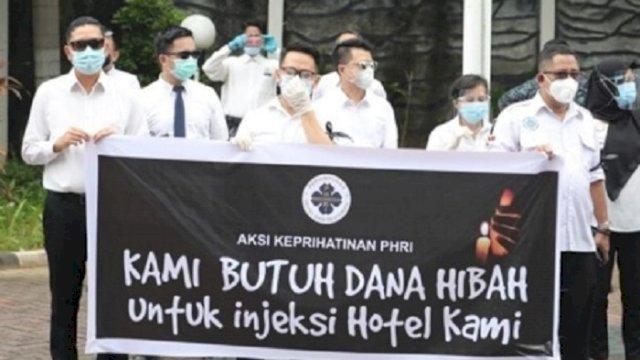 Aksi demo dari PHRI yang menuntut pencairan dana hibah dari Kemenkepraf, Rabu (3/2/2021). (int)